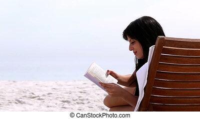 Brunette reading a book