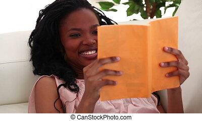 Brunette reading a novel