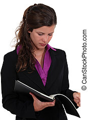 Brunette reading contents of folder