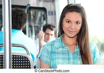 Brunette riding on tram