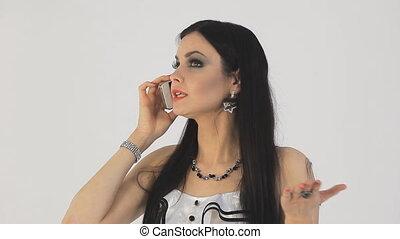 Brunette screaming on the phone. white background
