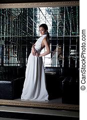 Brunette sexy woman in white dress