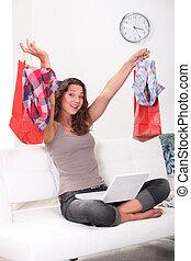 Brunette shopping online at home