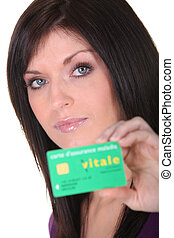 brunette showing social security card