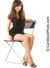 Brunette sitting in chair
