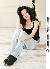 Brunette sitting on floor