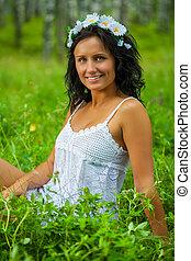 brunette sitting on grass