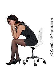 Brunette sitting on office chair