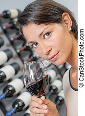 Brunette smelling a glass of wine
