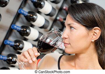 Brunette smelling wine