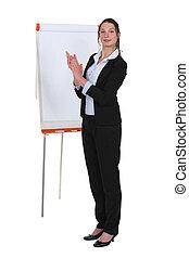 Brunette stood applauding by flip chart