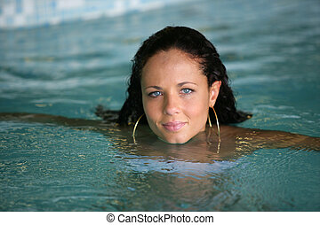Brunette swimming in pool