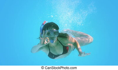 Brunette swimming underwater