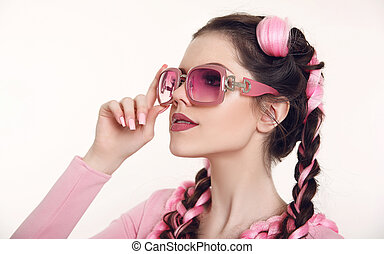 Brunette teen girl with two french braids from pink...