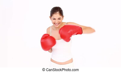 Brunette throwing punches against white background