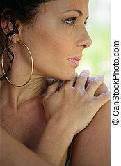 Brunette touching shoulder