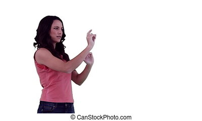 Brunette using a virtual touchscreen with both hands against...