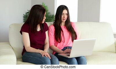 Brunette using laptop and chatting