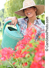 Brunette watering flowers