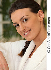 brunette wearing bathrobe