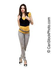 Brunette wearing grey jeans