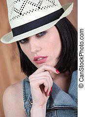 Brunette wearing hat