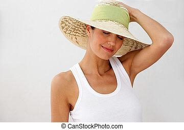 Brunette wearing straw hat