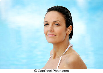 Brunette wearing white bikini