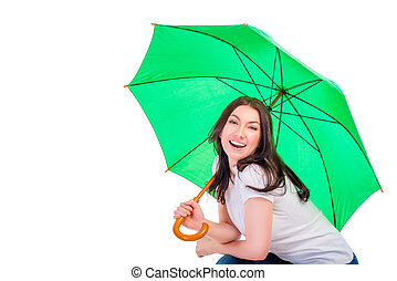 brunette with a green umbrella isolated