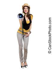 Brunette with a loudspeaker