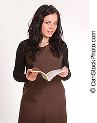 Brunette with apron and book