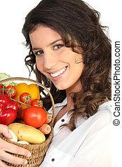 brunette with basket of vegetables