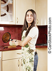 Brunette with frying pan