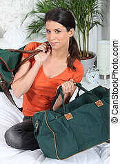 Brunette with hand luggage