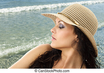 brunette with hat