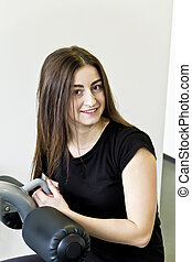 Brunette with long hair to train in gym - Vertical photo of...
