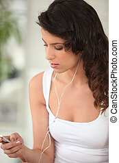 Brunette with mp3 player