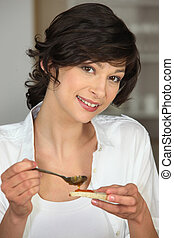 Brunette with slice of bread