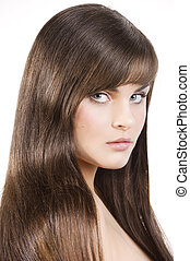 young cute woman with long and smooth black hair isolated on white