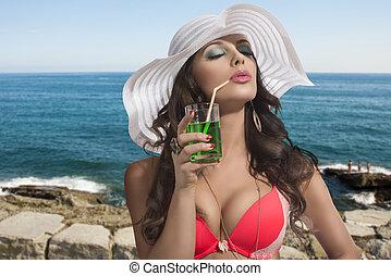 brunette with summer hat taking sun