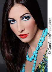Brunette with turquoise beads - Portrait of beautiful...