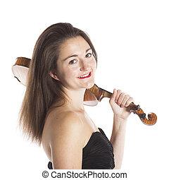 brunette with violin on shoulder in studio