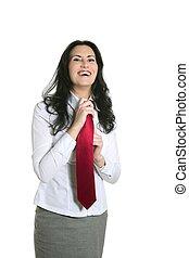 Brunette woman adjusting her necktie