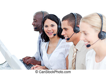 Brunette woman and her team working in a call center