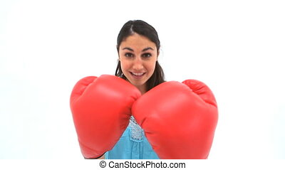 Brunette woman boxing with red gloves