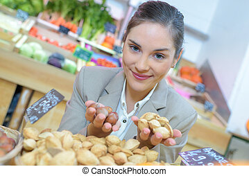 brunette woman buying potatoes at the supermarket