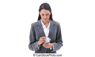 Brunette woman counting her notes