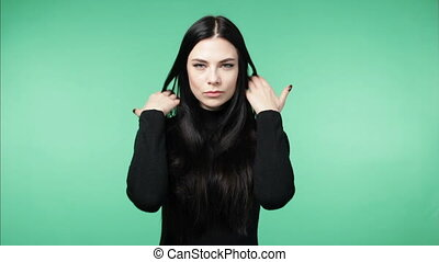 brunette woman demonstrating long healthy hair - Young...