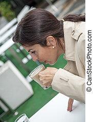 Brunette woman drinking coffee