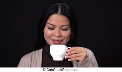 Brunette Woman Drinking Coffee with a White Cup.